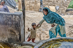 The grandmother's work (Pejasar) Tags: family business sugarcane processing neardelhi india grandmother work protection childcare grandson child labor