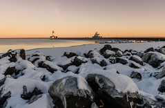 Winter Sunset at the Duluth Lakewalk, Canal Park (Tony Webster) Tags: canalpark duluth january lakesuperior minnesota harbor ice lakewalk lighthouse rocks snow sunset winter unitedstates us