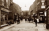 Norfolk Street, Wisbech (footstepsphotos) Tags: wisbech norfolkstreet people shop store stevenson postoffice horse carriage bicycle old vintage postcard past historic