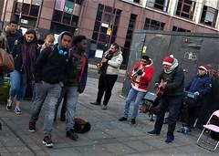 jingle bell rock (LozHudson) Tags: fuji xt10 fujifilmxt10 manchester streetperformers streetmusicians band music buskers street streetphotography