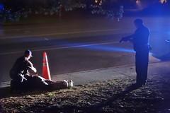 DSC08253 (David Housewright) Tags: man arrest millcreek gun police ground handcuff streetphoto street candid unposed