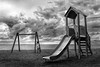 playing with loneliness (dim.pagiantzas | photography) Tags: girl kids kid people woman female beach sky clouds cloudy nature sea seascape landscape sand playground grayscale blackandwhite bw monochrome outdoor street photography