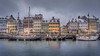 Snowy Weather in Nyhavn (Jacob Surland) Tags: architecture art boat boats building calm calmwater canal capital caughtinpixels city citybynight citylife cityscape copenhagen copenhagenbynight country cozy denmark evening fineart fineartphotography fishingboat geometry hdr harbor harborofcopenhagen harbour highdynamicrange highstreet historic historiccentre hygge jacobsurland københavn light lights lines longexposure mood moody newharbor newportcopenhagen night nyhavn oldbuilding oldship reflections restaurant restaurants sailboat sailship ship ships shopping smoothwater snow snowy sunrise time tourism transport transportion travel traveldestination travelandtourism twillight urban warmfeeling warmlight water waterfront winter