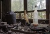 Smith's workbench [in explore December 2017] (kentkirjonen) Tags: workbench bottles abandoned old lumix fz300 window trees rust unorganised nail fuse bottle branch distributor