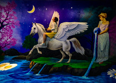 Enjoying the Ride (Steve Taylor (Photography)) Tags: stetson hat pegasus maiden horse art mural colourful happy fun smiling woman lady asia singapore flower blossom tree grass jug stream water lake moon stars