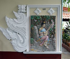 bas relief on a temple buildig (the foreign photographer - ฝรั่งถ่) Tags: bas relief woman playing lute buddhist temple wat prasit mahathat bangkhen bangkok thailand nikon d3200