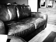 Worn Leather Sofa. (ManOfYorkshire) Tags: sofa lounge furniture worn leather old bw blackwhite home house style quality settee seating 2seatsofa christopherpratts brown salmon fish cushion