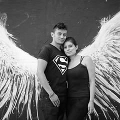 Love with wings (RoryO'Bryen) Tags: wingsofdesire people lovers bogotá city streets portrait retrato roryobryen rolleiflex 28 ilfordfp4 selfdeveloped analogue 120mm mediumformat formatomedio mittelformat copyrightroryobryen colombia colombie santafédebogotá lovewithwings