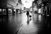 Rainy new year's day doggy walk (AlphaAndi) Tags: mono monochrome leute people personen urban trier tiefenschärfe wow rain rainy regen dof fullframe vollformat sony streets streetshots doggywalk menschen menschenbilder strase streetlife streetszene