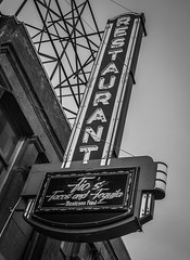 Restaurant Sign (tim.perdue) Tags: downtown urban city columbus ohio olympus omd em10mkii mft micro four thirds tamron 14150mm restaurant sign tios tacos tequila mexicano food neon light letters text vertical vintage retro design black white bw monochrome