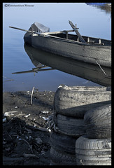 Closed (Kostas M.Z.) Tags: boat water blue old aged decaying abandoned tires fishing coastline dirty