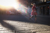 Verona Christmas Run (Roberto Spagnoli) Tags: verona color corsa correre run running girl controluce backlight babbonatale santaclaus fotografiadistrada streetphotography people christmasrun fujix100t italy sunbeams raggidisole beam iridescence