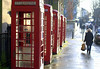 Telephone boxes in Preston (Tony Worrall) Tags: preston north northwest lancs lancashire england northern uk update place location visit area county attraction open stream tour country welovethenorth unitedkingdom english british capture outside outdoors caught photo shoot shot picture captured urban street damp rainy phone telephone callboxes icon iconic red candid people walk streetphotography person picturesinthestreet photosofthestreet