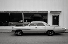 Star Chief, Tekoa, Washington (austin granger) Tags: starchief tekoa washington palouse pontiac vintage dealership car design sidewalk era time reflection film gw690