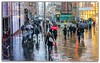 A Sign of What Was To Come... (Gordon McCallum) Tags: buchannansteet pedestrianprecinct snow streetscene streetperformer shoppers umbrellas glasgow glasgowsubway sony sonya6000 scotland winter sundaylights