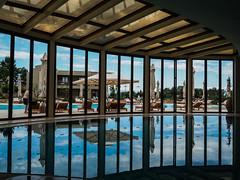 Porto Sani, Greece (colinhoran83) Tags: pinstripes minimal reflection sunny greece swimming pool water architecture