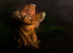 Music by Candlelight - HMM! (suzanne~) Tags: angel flute ornament macro candlelight christmas seasonal lensbaby composerpro sweet80 texture macromondays litbycandlelight