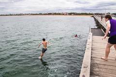 Splash (explored) (Greenstone Girl) Tags: mordiallocbeach sand summer beachumbrella clouds heathaze pier seagulls sky