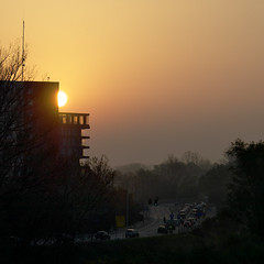 sunset in a city (Darek Drapala) Tags: sun sky silhouette skyskape street city civilization urban europe silkypix evening panasonic poland polska panasonicg5 warsaw warszawa architecture