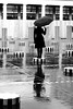 The small woman who wanted to be big (pascalcolin1) Tags: paris buren colonnes columns pluie rain reflet reflection photoderue streetview urbanarte noiretblanc blackandwhite photopascalcolin 50mm canon50mm canon colonnesdeburen parapluie umbrella