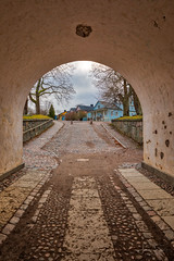 Archway to Adventure (lsten) Tags: fortress tree trees arch bracketing calm peaceful finland travelphotography alcove city suomenlinna winter helsinki afternoon clouds iso100 hdr cityscape tripod road amateurphotography bracketed canonef1635mmf4lisusm f13 sleepycity architecture sky 23mm serenity canoneos5dmarkiv mystical sveaborg uusimaa fi
