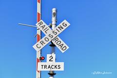 Cross Bucks (D Allen Johnson Photography) Tags: unitedstates newmexico santafe railyard rail yard cross buck crossing train locomotive track outdoor crossbuck road railroad sky sign text warning caution