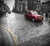 SCOTTISH CAB (champollion-10) Tags: city cityscape blackandwhite cutout street cobblestones red cab rojo taxi ciudad