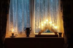 Happy New Year (vesna1962) Tags: window windowsill candlebridge candle vase curtains lacecurtain glow bluelight winter christmas endofyear festive interior room home stilllife