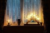 Happy New Year (vesna1962) Tags: window windowsill candlebridge candle vase curtains lacecurtain glow bluelight winter christmas endofyear festive interior room home stilllife
