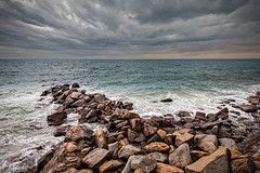 Artificial cliff made big stones. (franco nadalin) Tags: beach bluff cliff clouds coastline hanger landscape panorama reef rock rocks sea seascape seashore sky steep stones stormy water waves wideangle