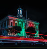 holidays at city hall (pbo31) Tags: bayarea california nikon d810 color night dark black boury pbo31 december 2017 holidays lights christmas tree season panorama stitched large panoramic southsanfrancisco sanmateocounty cityhall lightstream motion traffic roadway street red structure architecture