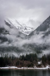 Clouds hiding snow capped peaks. Diablo Lake, Washington