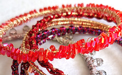 Solstice red bead bangle pile (vashtirama) Tags: designingvashti crochetjewelry bangle crochetbracelet coveredring beaded beads