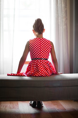 (Rebecca812) Tags: girl child dress polkadots red highponytail 1950s vintage bench window home woodfloors curtains canon people rearview mysterious sunlight rebeccanelson rebecca812