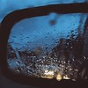 Dripping in coma (GrandPinapple) Tags: panning square blur dripping car rearmirror coma water rain icm