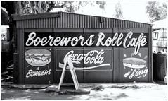 Boerewors Roll Café (Finepixtrix) Tags: market stall krugersdorp mogalecity westrand finepix s5600 cocacola coke sign hut boereworsroll fujifilm