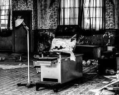 South Carolina Abandoned Mental Hospital: The Chair (that_damn_duck) Tags: blackwhite monochrome abandoned asylum urbex urbanexplorer medicalequipment decaying mentalhospital debris bw blackandwhite