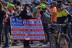 In Our America (swong95765) Tags: sign protest demonstrators police people flag message