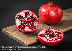 Sliced Pomegranate Fruit (Southern New England Photography) Tags: raw eating many color love lifestyle healthy detail colorful bounty arrangement foodportfolio readytoeat objects red diet seeds seasonal delicious pomegranate ingredient bright cuttingboard nutrition freshness food ripe fresh fruit juicy organic dining foodconsumption meals foxboro ma unitedstates usa