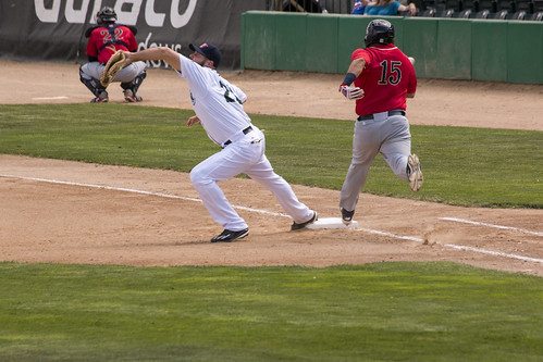 Error on the throw at first base - Lincoln Saltdogs runner is safe