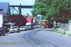 P&LE 2057, nb, W. Brownsville, PA. 5-09-1986 (jackdk) Tags: train railroad railway locomotive emd emdgp38 emdgp382 gp38 gp382 ple pittsburghandlakeerie monongahela monongahelarailway coal coaltrain coaldrag streettrackage standardcab brownsvillepa westbrownsville westbrownsvillepa