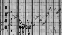 Cranes (laga2001) Tags: reflection office building architecture pattern structure texture glass windwos facade monochrome black white bnw blackandwhite berlin construction work multiple lines