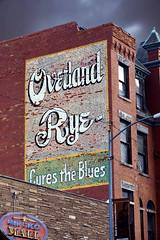 Holidays gotcha Down? (Owen Dett) Tags: montana liquor rye blues ghost sign depression red brick yellow blue small town