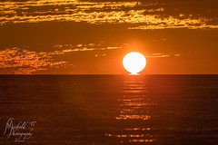 A Little Extra Sun (Michael Allen Siebold (Getty Images Contributor)) Tags: sun sunset water gulfofmexico clouds