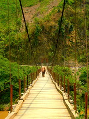 Cross Someone, Across the Bridge (Eye of Brice Retailleau) Tags: angle beauty composition landscape outdoor panorama paysage perspective scenery scenic view extérieur travel chemin bridge pont stream river countryside path camino canyon mountains green people vanishing point asia vietnam