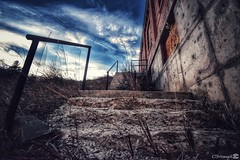 Crumbling Concrete Stairs (CTfotomagik) Tags: stairs concrete crumbling nikon wideangle colorado gatewaynaturalarea larimercounty decay weathered steps brick building 1020mm sky railing perspective