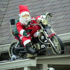 I'm sure Santa will be going out on New Year's Eve on his Harley. (kennethkonica) Tags: xmas christmas happyholidays snowman window frosty red color canonpowershot canon indianapolis indiana indy midwest usa america fun random hoosier glass santaclaus roof motorcycle biker santa decorations funny