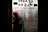 Black Milk (ewitsoe) Tags: entrance door handsign sign painted woman walking wet redhat steamedwindow rain water winter cold chill warmisdie steeam ewitsoe canoneos6dii 50mm 12f poznan poland city vibes coffeeshop jezyce cityscape urban drink espresso