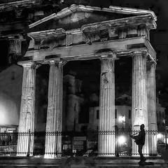 The sudden dream of a street singer. (AchillWandering) Tags: street singer monument columns doric night athens greece ancient guitar urban dream gate bw blackandwhite