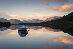 Just a boat (chrismarr82) Tags: nikon sunset scotland boat reflection mountains
